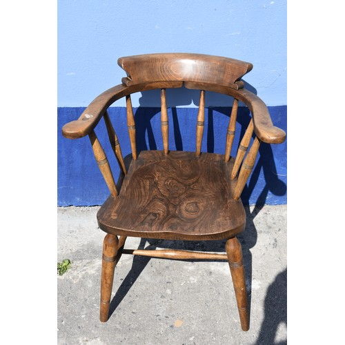 558 - A VICTORIAN ELMWOOD SMOKERS BOW CHAIR