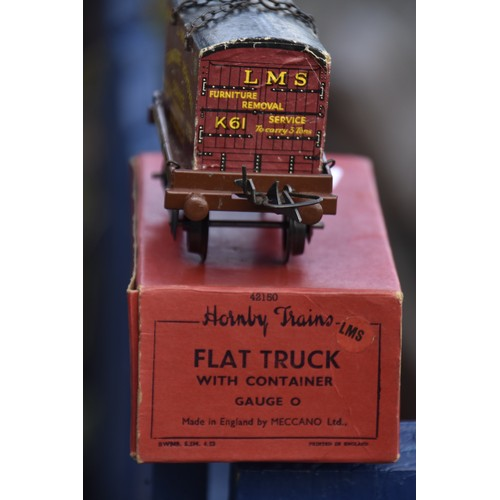 600 - VINTAGE O GUAGE HORNBY TRAINS FLAT TRUCK WITH CONTAINER ( LMS FURNITURE REMOVAL SERVICE) BOXED AND I...
