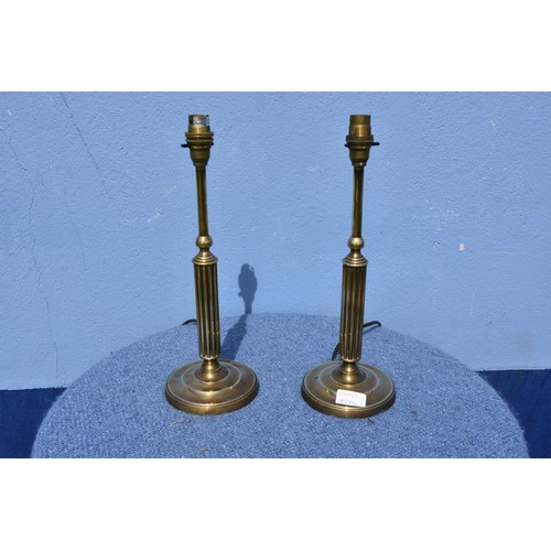 129 - A PAIR OF BRASS PILLAR LAMPS