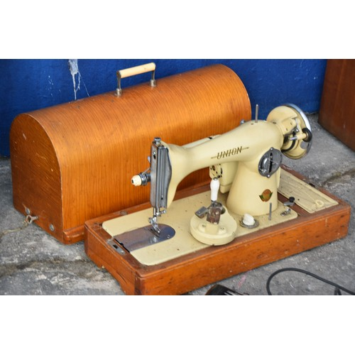 183 - CASED SEWING MACHINE COMPLETE