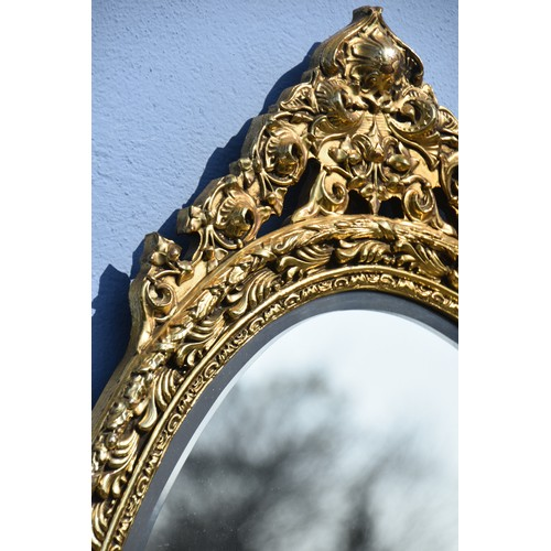 567 - ORNATE GILT BEVELLED EDGED MIRROR