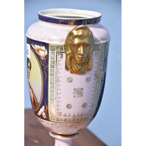 502 - A PORCELAIN VASE WITH GILT HEADS TO SIDE IN ROYAL VIENNA STYLE 11