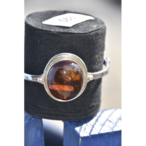 220 - SILVER BANGLE WITH LARGE AMBER STONE