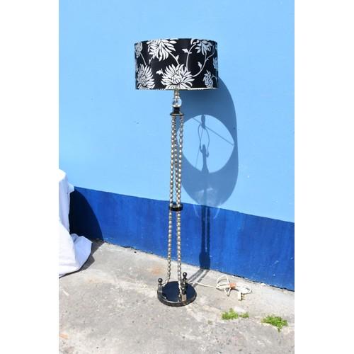 7 - A 3 LEG CHROME STANDARD LAMP WITH SHADE