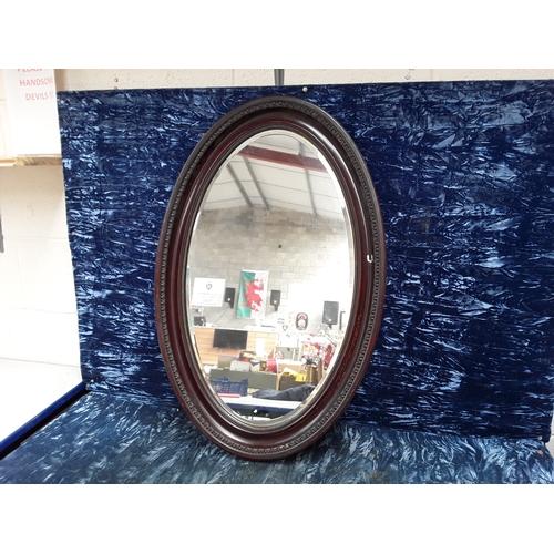 51 - Oval Georgan style mirror...