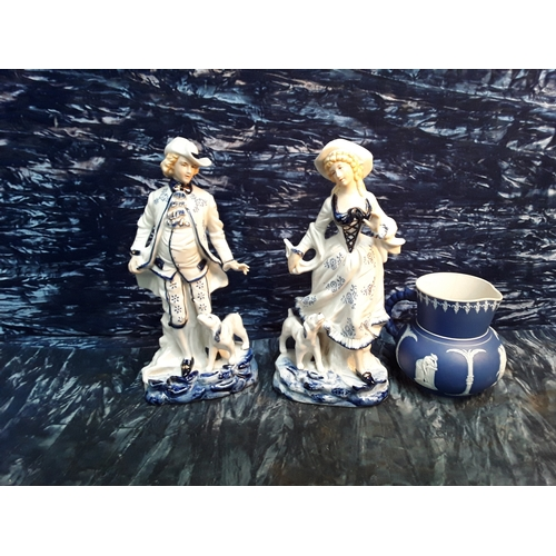 7 - Two Staffordshire figures and blue and white jug...