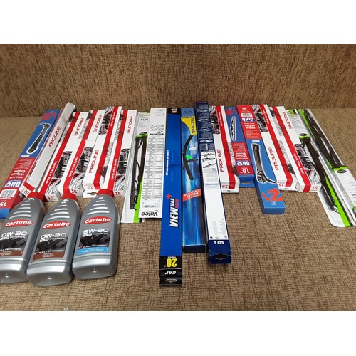 26 - Large quantity of windscreen wiper blades and engine oil...