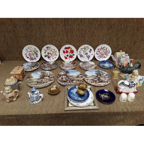 45 - Selection of collectible plates and teapots including Royal Albert...