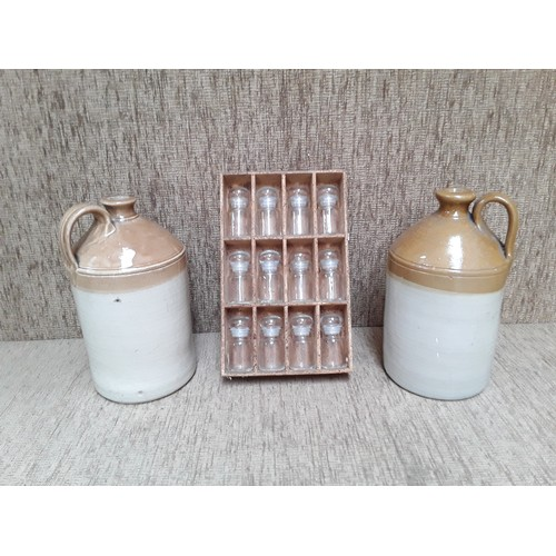 41 - 2 stone ware flagons and set of Spice jars...
