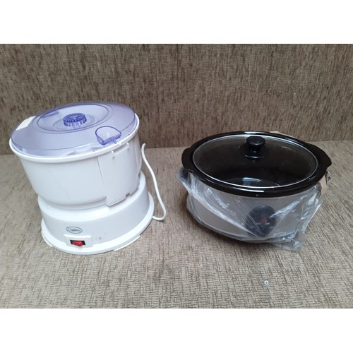 47 - Electric Slow Cooker and potato peeler...
