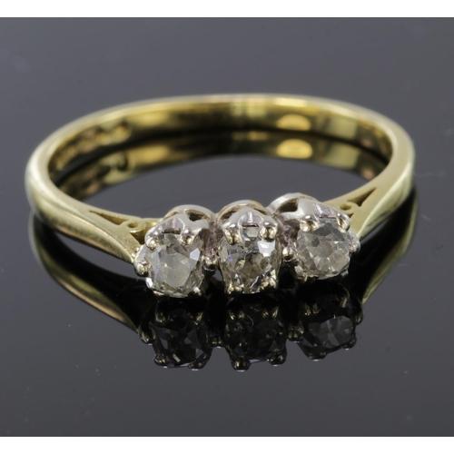 26 - 18ct Gold three stone Diamond Ring size L weight 2.6g...