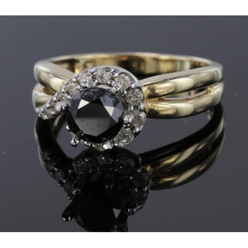 31 - 10ct Gold Ring with central 0.75ct Black Diamond with white diamond shoulders size L weight 3.7g...