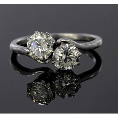 34 - Platinum ring set with two diamonds, each calculated to weigh approx. 0.75ct. Finger size M, weight ...
