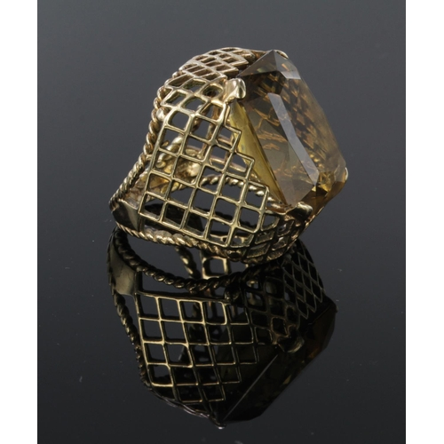 40 - 9ct gold smoky quartz dress ring with lattice mount, finger size L weight 10.6g...