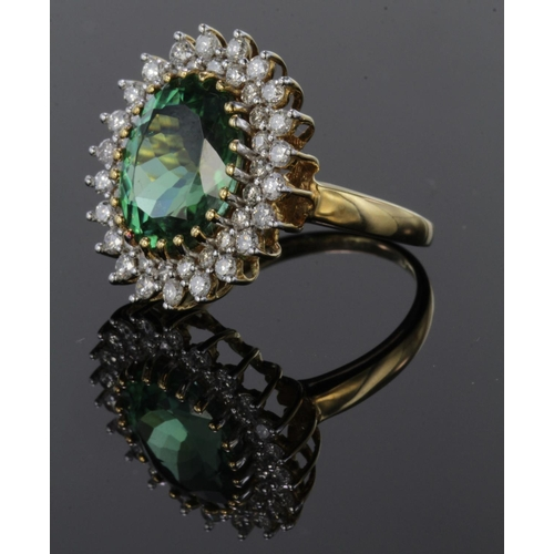 41 - 18ct yellow gold oval cluster ring set with central oval green paraiba tourmaline weighing 4.7ct, su...