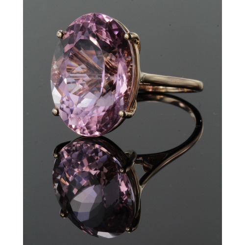 42 - 14ct rose gold single stone ring set with natural oval Brazillian Kunzite weighing 25.03ct. Finger s...