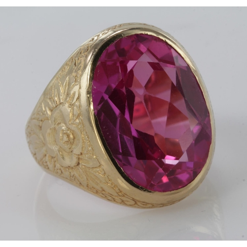 47 - 18ct Gold Ring with large Pink synthetic stone size R weight 22.3g...