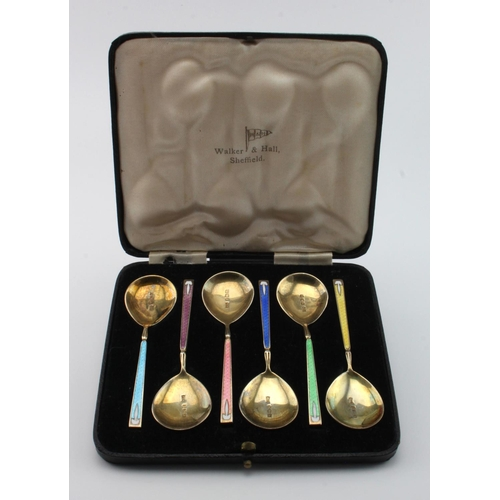 728 - Boxed set of six silver & enamel teaspoons by Walker & Hall hallmarked for Birmingham, 1937. Weight ...