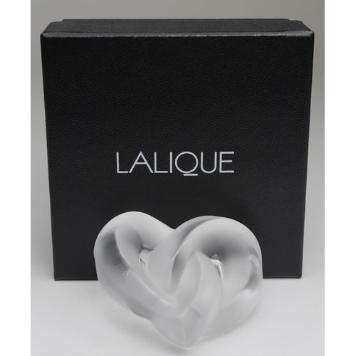 666 - Lalique glass paperweight, depicting an intertwined heart, signed to reverse, contained in original ...