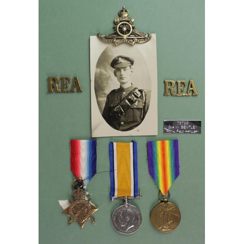 31 - 1915 Star Trio to 76799 Gnr W Bentley RFA. With badges and photo postcard.  (3)...