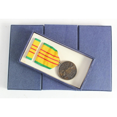 978 - Vietnam War Unissued US Vietnam Service Medals in original boxes and wrapped in the original paper. ...