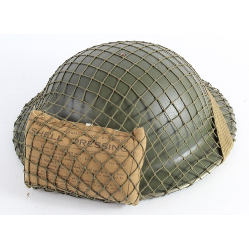 997 - WW2 British Tommy Helmet with cam net and field dressing....
