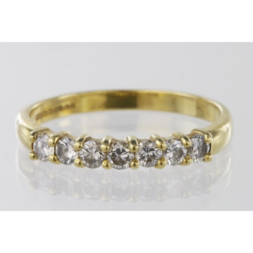 37 - 18ct hallmarked seven stone Diamond Ring (approx 0.35ct weight) size O weight 2.7g