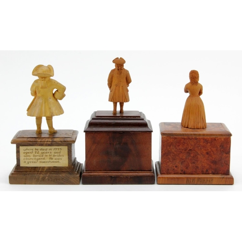 371 - Three hand carved wooden figures, depicting interesting characters in history, each mounted on a han...