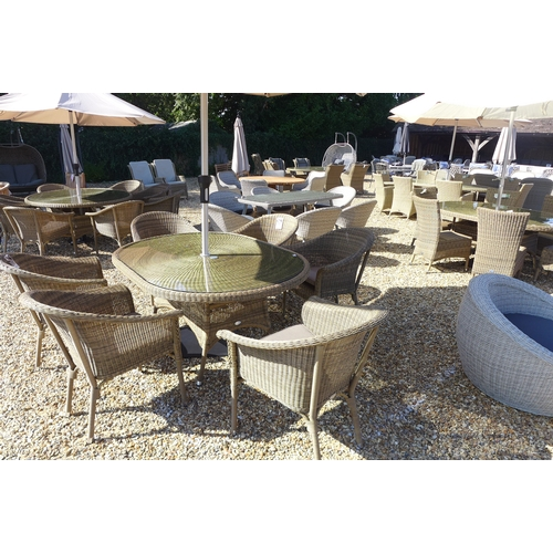 40 - A Bramblecrest Sahara 170 x 115cm oval table and Sahara stacking bistro chairs including taupe cushi...