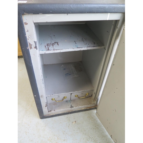 23 - A steel safe with two internal drawers and a main door key, with a plaque for The Empire Safe Compan...