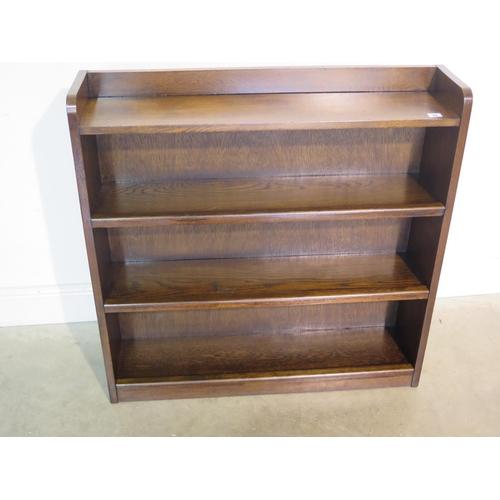 28 - A 20th Century oak open book case 92cm H x 92cm W x 21.5cm D...