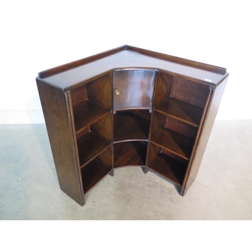 30 - A circa 1930s oak corner open book case 80cm H x 21cm D x 68cm W on each side...