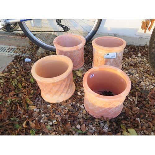 39 - Four terracotta planters - diameter 23cm...