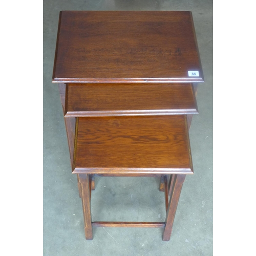 44 - A 1930s oak nest of three tables, overall approximately 46cm wide, 34cm deep and 54cm high, some cos...