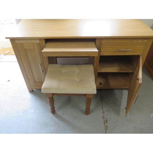 20 - A modern oak desk with central slide and two cupboards - 77cm H x 141cm x 56cm with a stool...