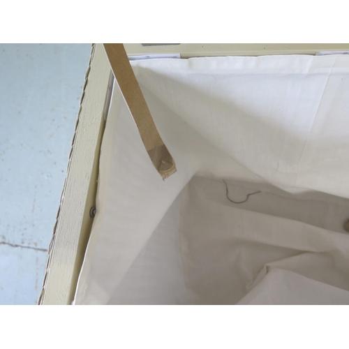 23 - A modern Lloyd loom linen basket 58cm H x 90cm x 46cm...