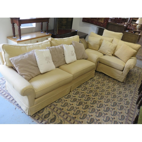 41 - A Duresta three seater sofa with scatter cushions and a matching smaller sofa...