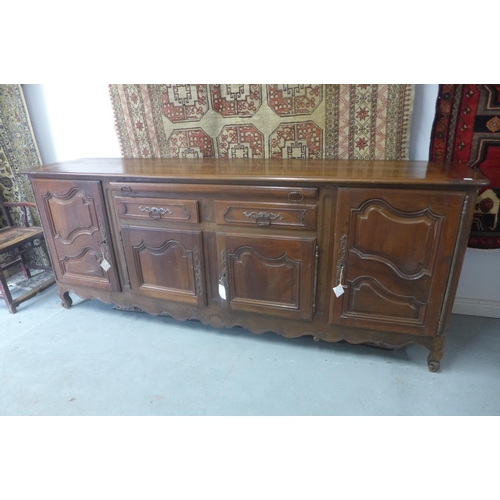10 - An 18th/19th Century continental walnut fruitwood sideboard with a slide over two drawers with four ...