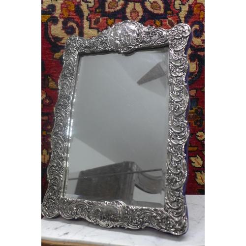 23 - A silver effect easel back mirror - 48cm H x 32cm W...