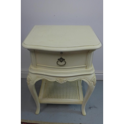 26 - A cream painted bedside chest...