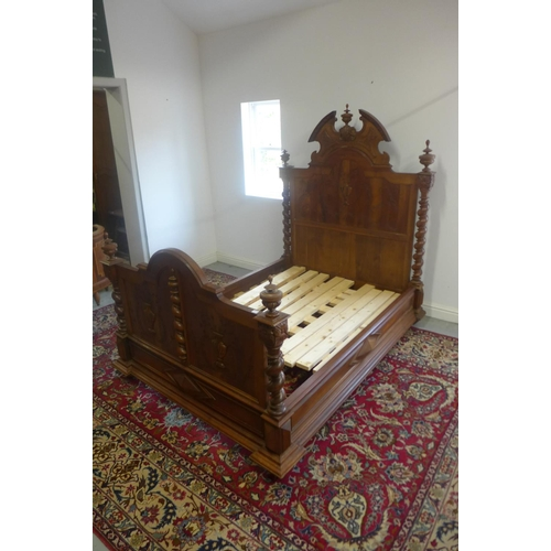 35 - A 19th Century continental walnut double bed with barley twist supports - 186cm H x 150cm W, with wo...