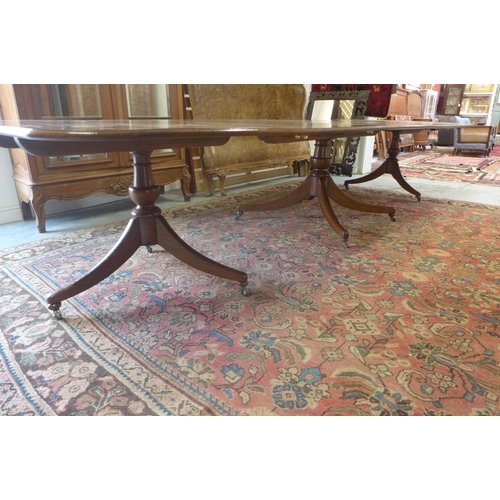30 - An oak triple pod dining table with  two extra leaves - 72cm H x 126cm x 398cm extended...