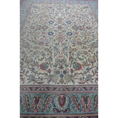 63 - A hand knotted woollen rug with Caucasian ground and pale blue boarder, approx 388cm x 292cm -with s...