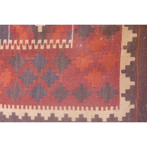 58 - A hand knotted Kelim rug, some general usage wear, 340cm x 142cm...