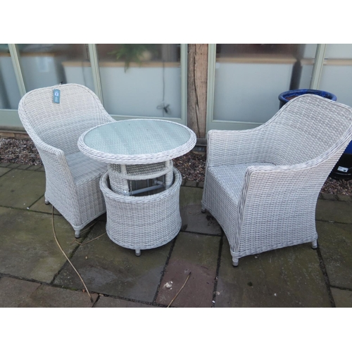 55 - A Bramblecrest Monte Carlo bistro set with adjustable table and two arm chairs with cushions...