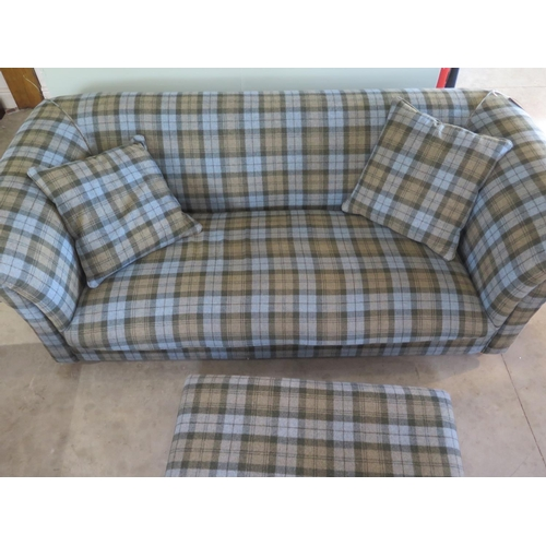 18 - A bespoke made three seater sofa in a tartan material - 70cm H x 215cm W x 105cm with footstool and ...