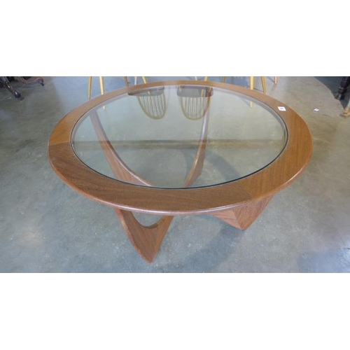 20 - A G Plan teak coffee table - 84cm wide, with a glass top...