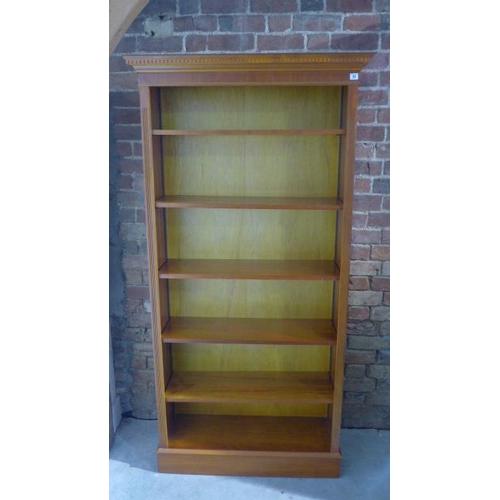 31 - A tall 20th century yew wood open book case with adjustable shelves, approx 190cm x 96cm x 34cm  - i...