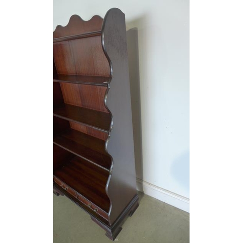 34 - A 20th century mahogany waterfall open book case, two lower frieze drawers - approx 154cm x 78cm x 3...
