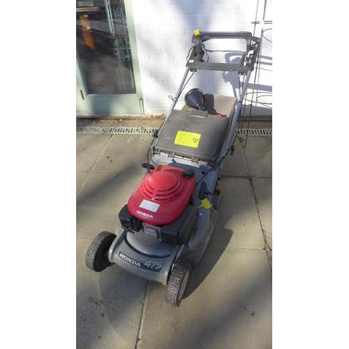 44 - A Honda HRB 475 petrol driven lawnmower, starts and runs, may need a service...